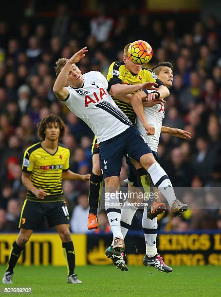 Ben Watson of Watford competes for the ball against Harry Kane and Erik Lamela of Tottenham Hotspur during the Barclays Premier League match between...