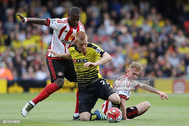 Ben Watson of Watford is challenged by Rees Greenwood and Dame N'Doye of Sunderlandduring the Barclays Premier League match between Watford and...