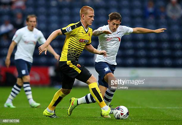 Ben Watson of Watford is closed down by Josh Brownhill of Preston North End during the Capital One Cup second round match between Preston North End...
