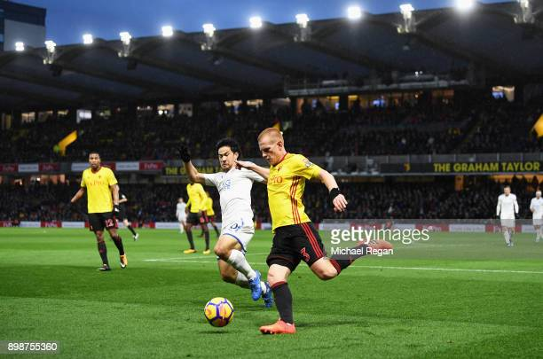 Ben Watson of Watford is closed down by Shinji Okazaki of Leicester City during the Premier League match between Watford and Leicester City at...