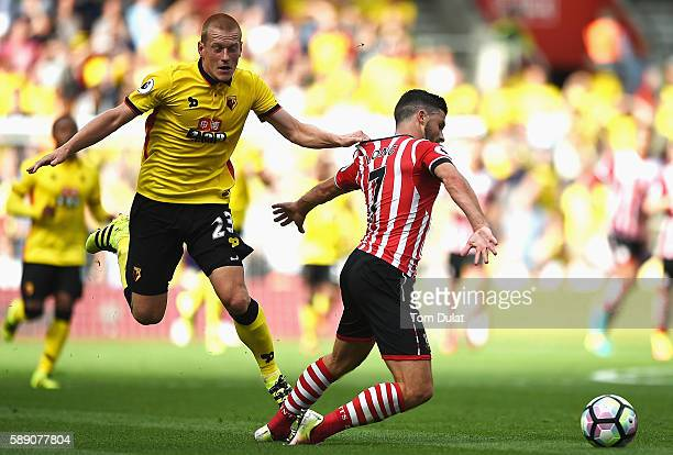 Ben Watson of Watford pulls Shane Long shirt and is sent off during the Premier League match between Southampton and Watford at St Mary's Stadium on...