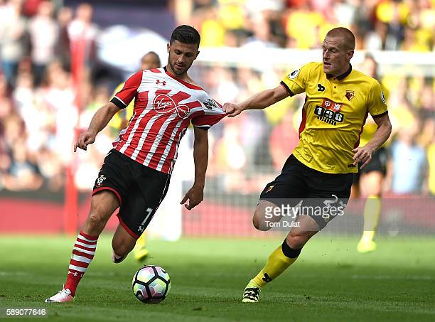 Ben Watson of Watford pulls Shane Long's shirt during the Premier League match between Southampton and Watford at St Mary's Stadium on August 13 2016...