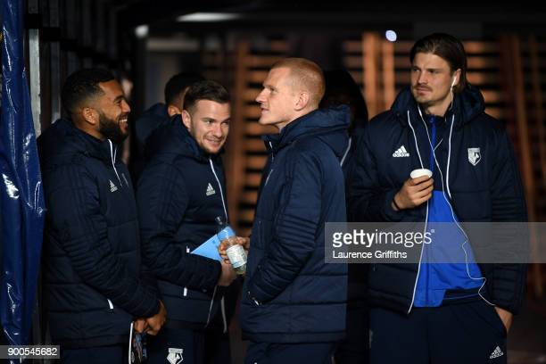 Ben Watson of Watford speaks to Tom Cleverley of Watford in the tunnel prior to the Premier League match between Manchester City and Watford at...