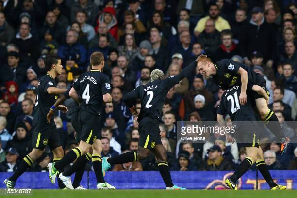 Ben Watson of Wigan Athletic celebrates scoring their first goal with team mates during the Barclays Premier League match between Tottenham Hotspur...