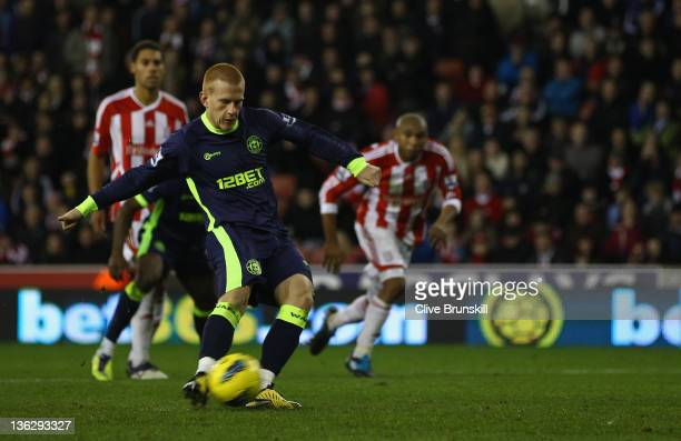 Ben Watson of Wigan Athletic scores his teams equaliser from the penalty spot during the Barclays Premier League match between Stoke City and Wigan...