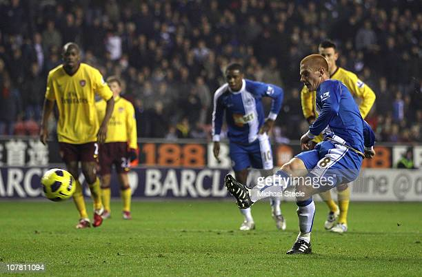 Ben Watson of Wigan Athletic scores the opening goal from a penalty during the Barclays Premier League match between Wigan Athletic and Arsenal at DW...