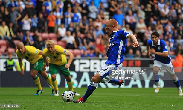 Ben Watson of Wigan scores a goal from the penalty spot during the Barclays Premier League match between Wigan Athletic and Norwich City at the DW...