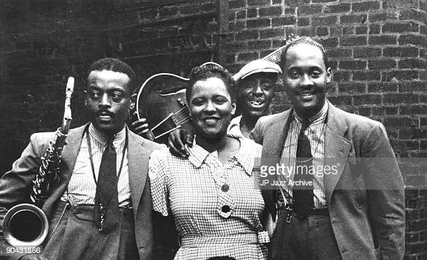Ben Webster Billie Holiday unknown guitar player and Johnny Russell pose in Harlem in 1935 in New York