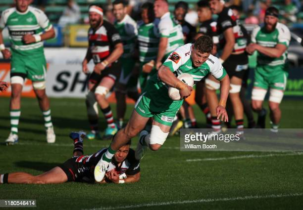 Ben Werthmuller of Manawatu slips a tackle to score a try during the round 10 Mitre 10 Cup match between Manawatu and Counties Manukau at Central...