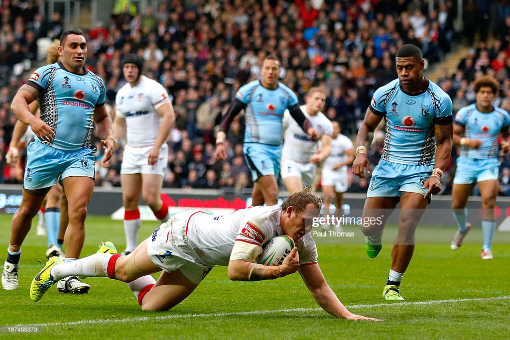 Ben Westwood of England dives over to score a try during the Rugby League World Cup Group A match at the KC Stadium on November 9, 2013 in Hull, England.