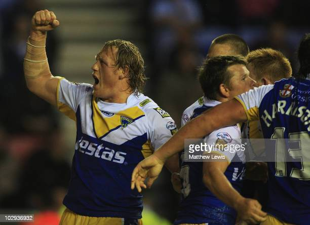 Ben Westwood of Warrington celebrates his try during the engage Super League match between Wigan Warriors and Warrington Wolves at the DW Stadium at...