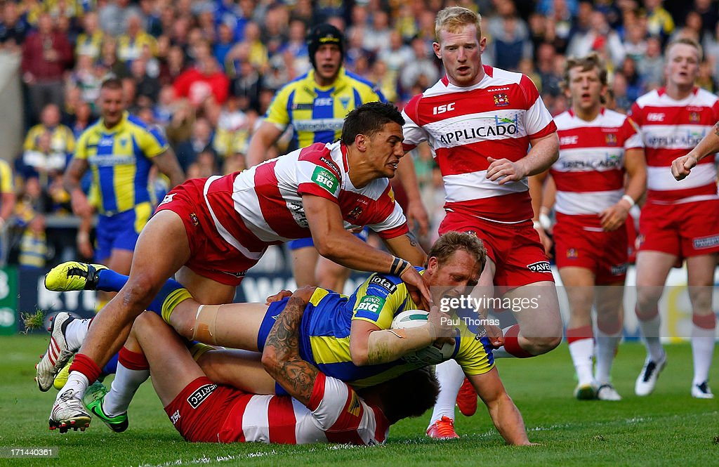 Ben Westwood of Warrington scores the opening try during the Super League match between Warrington Wolves and Wigan Warriors at the Halliwell Jones Stadium on June 24, 2013 in Warrington, England.