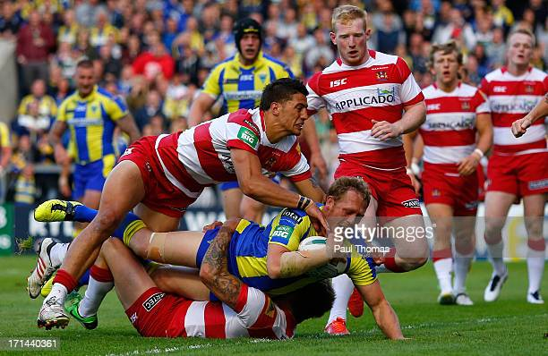 Ben Westwood of Warrington scores the opening try during the Super League match between Warrington Wolves and Wigan Warriors at the Halliwell Jones...
