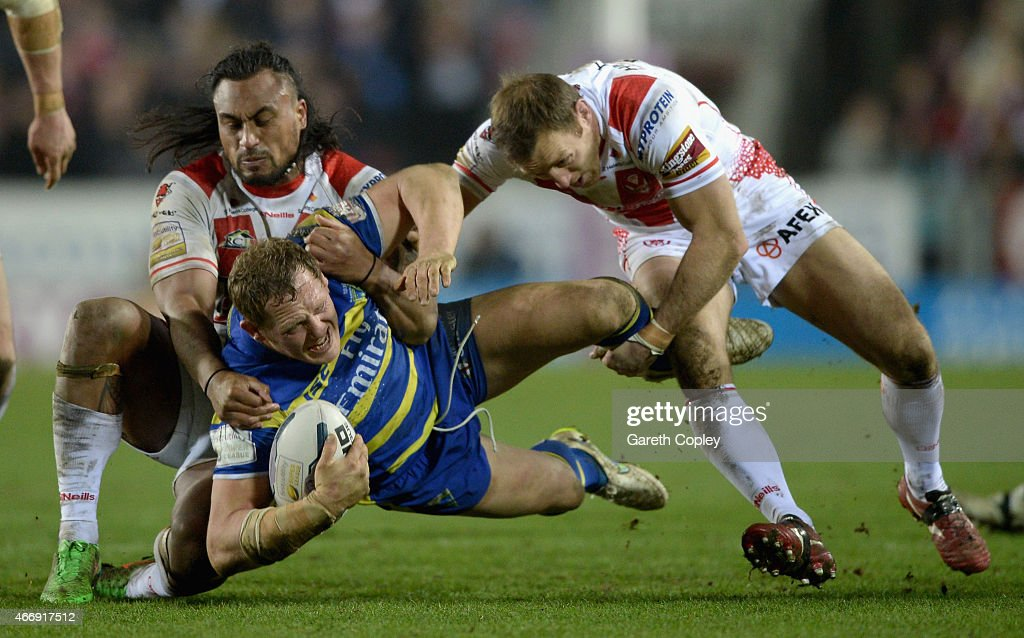 Ben Westwood of Warrington Wolves is tackled by Atelea Vea and James Roby of St Helens during the First Utility Super League match between St Helens and Warrington Wolves at Langtree Park on March 19, 2015 in St Helens, England.