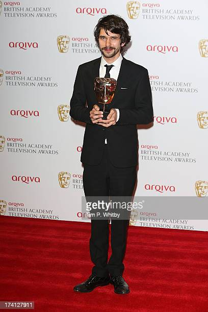 Ben Whishaw poses in the press room with his award for Best Leading Actor at the Arqiva British Academy Television Awards 2013 at the Royal Festival...