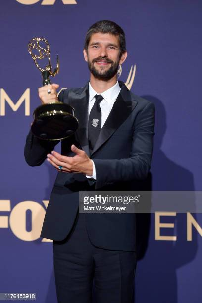 Ben Whishaw poses with award for Outstanding Supporting Actor in a Limited Series or Movie in the press room during the 71st Emmy Awards at Microsoft...