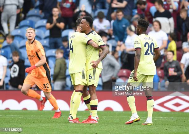 Ben White and Gabriel celebrate Arsenal's win after the Premier League match between Burnley and Arsenal at Turf Moor on September 18, 2021 in...