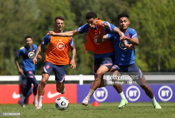 Ben White, Ben Godfrey and Ollie Watkins of England battle for possession during a training session at the England Pre-Euro 2020 Training Camp on May...