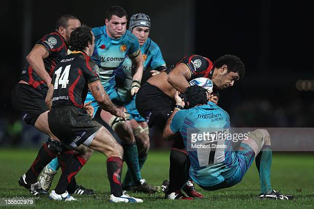 Ben White of Exeter Chiefs holds onto Toby Faletau of Newport Gwent Dragons during the Amlin Challenge Cup Pool Four match between Exeter Chiefs and...