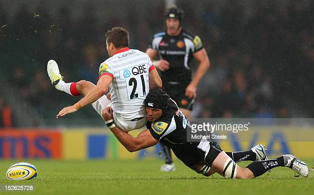 Ben White of Exeter Chiefs tackles Richard Wigglesworth of Saracens during the Aviva Premiership match between Exeter Chiefs and Saracens at Sandy...