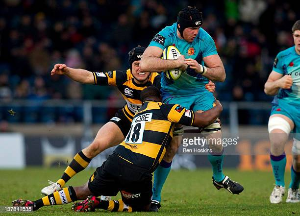 Ben White of Exeter is tackled by Simon McIntyre of Wasps during the LV= Cup match between London Wasps and Exeter Chiefs at Adams Park on January 28...
