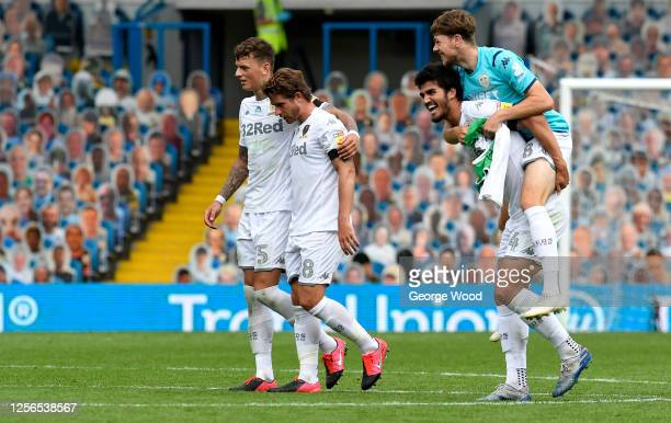 Ben White of Leeds United and Gaetano Berardi react during the Sky Bet Championship match between Leeds United and Barnsley at Elland Road on July...
