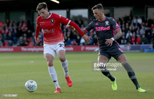 Ben White of Leeds United and Jake Beesley of Salford City compete for the ball during the Carabao Cup First Round match between Salford City and...