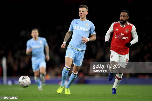 Ben White of Leeds United in action with Alexandre Lacazette of Arsenal during the FA Cup Third Round match between Arsenal and Leeds United at...
