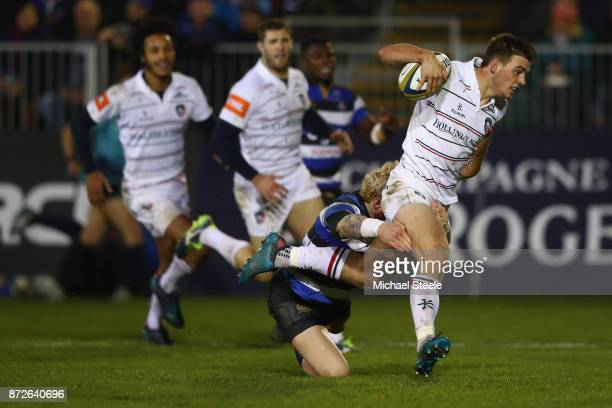 Ben White of Leicester holds off the challenge of Tom Homer to score a try during the AngloWelsh Cup Round 2 match between Bath Rugby and Leicester...
