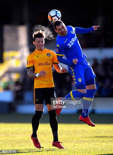 Ben White of Newport County and PierreMichel Lasogga of Leeds United in action during The Emirates FA Cup Third Round match between Newport County...