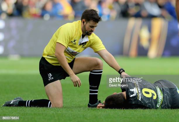 Ben Whitehouse the referee helps Morgan Parra of Clermont after the scrumhalf had been knocked out during the European Rugby Champions Cup match...