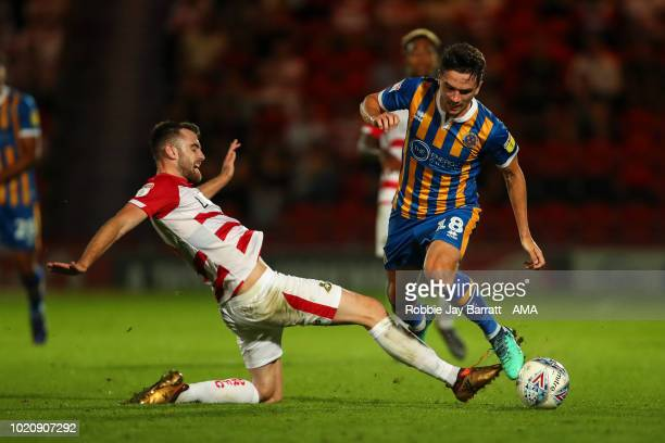 Ben Whiteman of Doncaster Rovers and Alex Gilliead of Shrewsbury Town during the Sky Bet League One match between Doncaster Rovers and Shrewsbury...