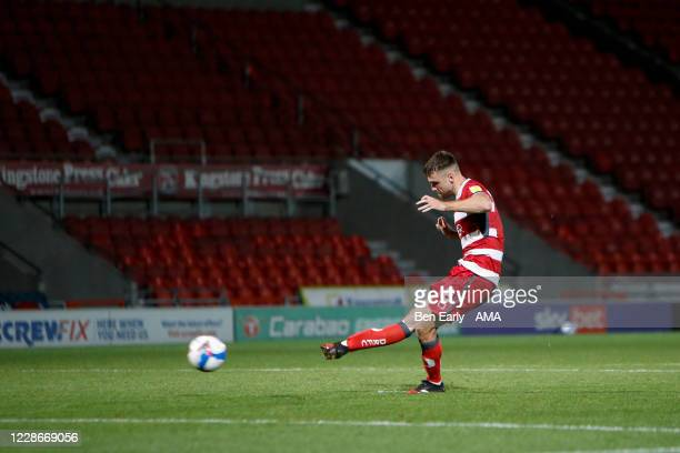Ben Whiteman of Doncaster Rovers takes his penalty during the EFL Trophy match between Doncaster Rovers v Bradford City at Keepmoat Stadium on...