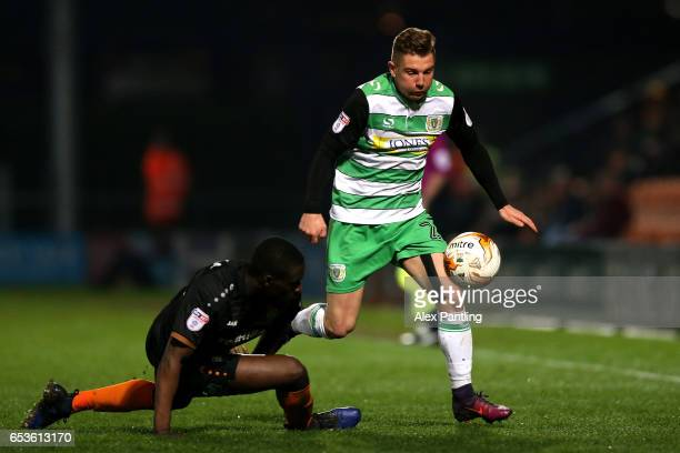 Ben Whitfield of Yeovil Town takes on Simeon Akinola of Barnet during the Sky Bet League 2 match between Barnet and Yeovil Town on March 15 2017 in...