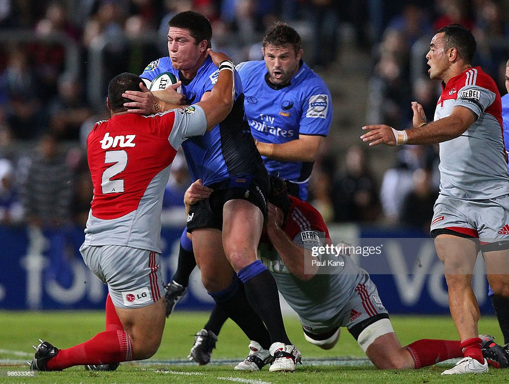 Ben Whittaker of the Force gets tackled by Ti'l Paulo of the Crusaders during the round 11 Super 14 match between the Western Force and the Crusaders at ME Bank Stadium on April 23, 2010 in Perth, Australia.
