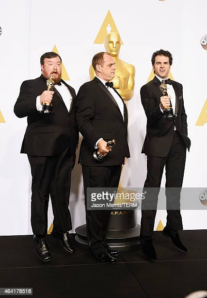 Ben Wilkins, Thomas Curley, and Craig Mann, winners of the Best Sound Mixing Award for 'Whiplash', pose in the press room during the 87th Annual...