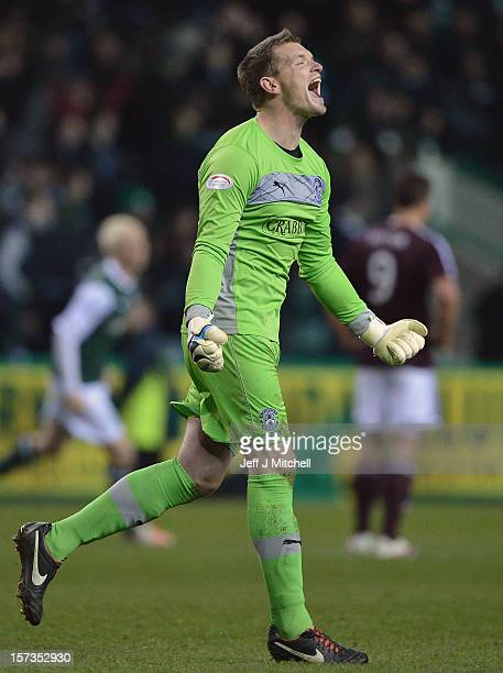 Ben Williams of Hibernian celebrates beating Hearts during the Scottish Cup match between Hibernian and Hearts at Easter Road Stadium on December 2...