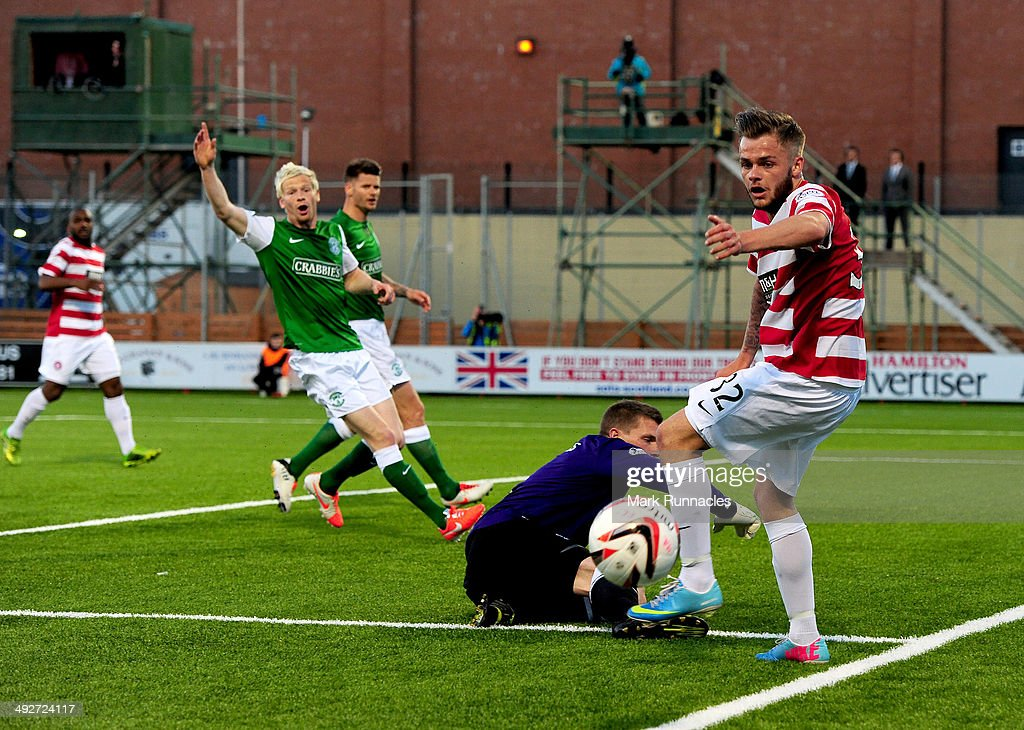 Ben Williams of Hibernian makes a crucial save from Andy Ryan of Hamilton during the 2-0 victory over Hamilton Academical in the Scottish Premiership Play-off Final First Leg, between Hamilton Academical and Hibernian at New Douglas Park on May 21, 2014 in Hamilton Scotland.