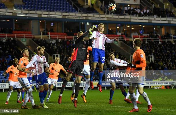 Ben Wilmot of Stevenage jumps with Anssi Jaakkola of Reading during The Emirates FA Cup Third Round Replay match between Reading and Stevenage at...