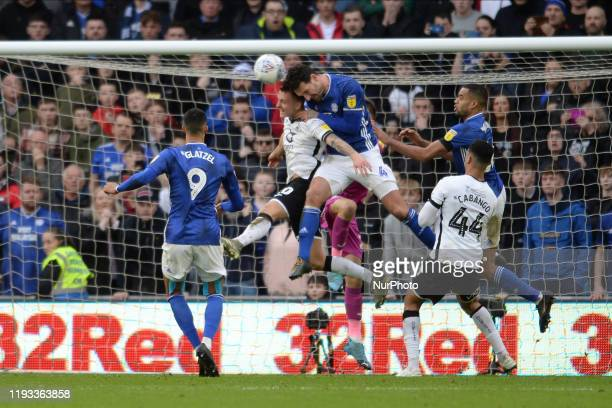 Ben Wilmot of Swansea City and Sean Morrison of Cardiff City battle for possession during the Sky Bet Championship match between Cardiff City and...