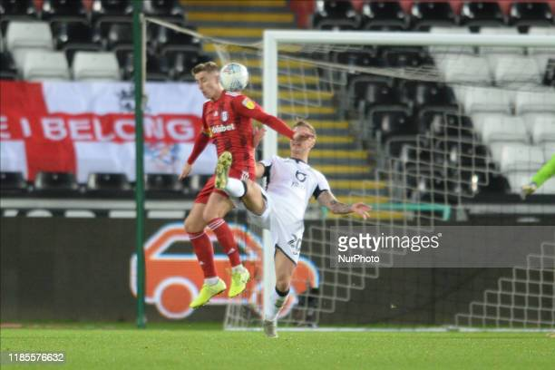 Ben Wilmot of Swansea City gets his foot to the ball first during the Sky Bet Championship match between Swansea City and Fulham at the Liberty...