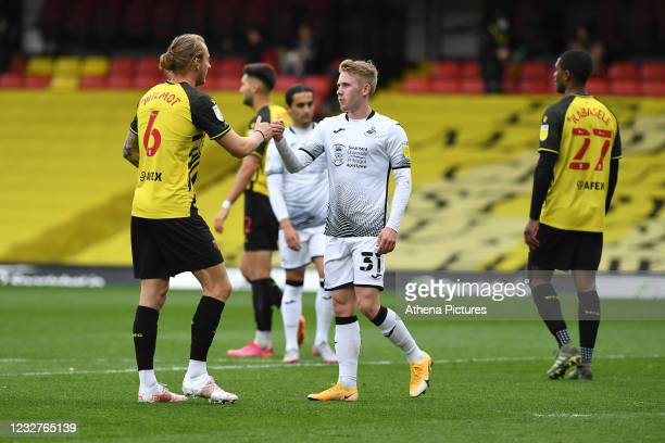 Ben Wilmot of Watford shakes hands with Oli Cooper of Swansea City at full time during the Sky Bet Championship match between Watford and Swansea...