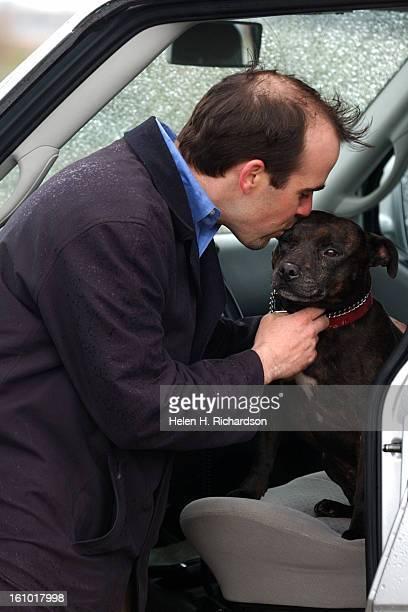Ben Wilson kisses his dog Buddy <cq> outside the Denver Municipal Animal Shelter <cq> at 666 S. Jason Street <cq> Buddy is an English Staffordshire...