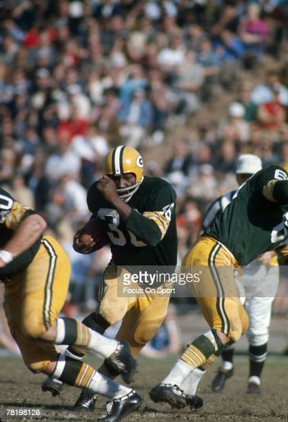 Ben Wilson of the Green Bay Packers carries the ball against the Kansas City Chiefs during Super Bowl I on January 15 1967 at the Memorial Coliseum...