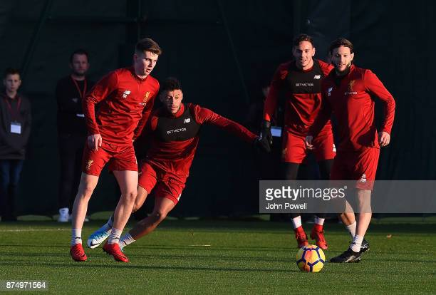 Ben Woodburn Alex OxladeChamberlain Danny Ward and Adam Lallana of Liverpool during a training session at Melwood Training Ground on November 16 2017...