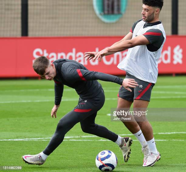 Ben Woodburn and Alex Oxlade-Chamberlain of Liverpool during a training session at AXA Training Centre on April 28, 2021 in Kirkby, England.