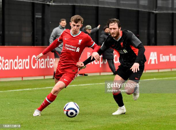 Ben Woodburn and Ben Davies of Liverpool during a training session at AXA Training Centre on March 20, 2021 in Kirkby, England.