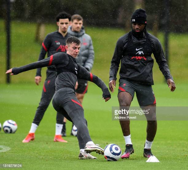 Ben Woodburn and Billy Koumetio of Liverpool during a training session at AXA Training Centre on May 21, 2021 in Kirkby, England.