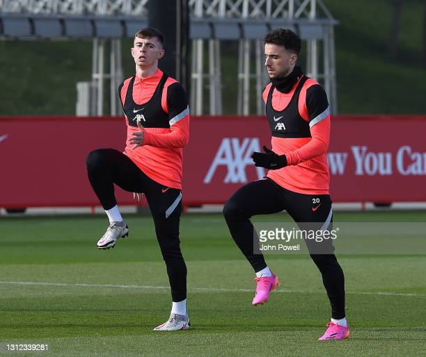 Ben Woodburn and Diogo Jota of Liverpool during a training session at AXA Training Centre on April 13, 2021 in Kirkby, England.