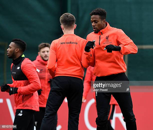Ben Woodburn and Divock Origi of Liverpool during a training session at Melwood Training Ground on January 6 2017 in Liverpool England
